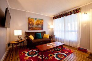 Living room of the Little Crooked House with it's very interesting colours / Le soon de la Petite maison croche avec ses couleurs intéressantes