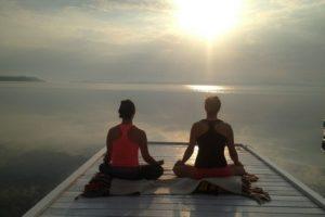 Vacation getaway morning meditation on dock at the Presidents' Suites and enjoying the sunrise on lake Temiskaming. / Méditation du matin sur le quai aux Suites des Présidents en profitant du levée de soleil sur le lac Témiskaming.