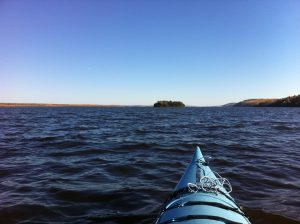 Kayaking to Farr Island on Lake Temiskaming.Our guests can use both our kayaks or canoes. / En route vers l'île Farr sur le lac Témiskaming. Nos clients peuvent utiliser nos kayaks ou canots.