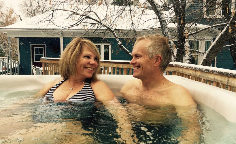 Couple enjoying spa at Lumber Baron House during their romantic getaway