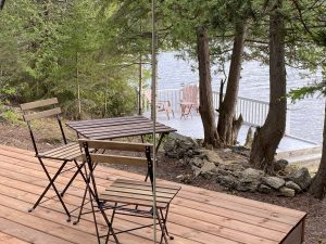 Two decks at the Large Rock Glamping Site on Farr Island