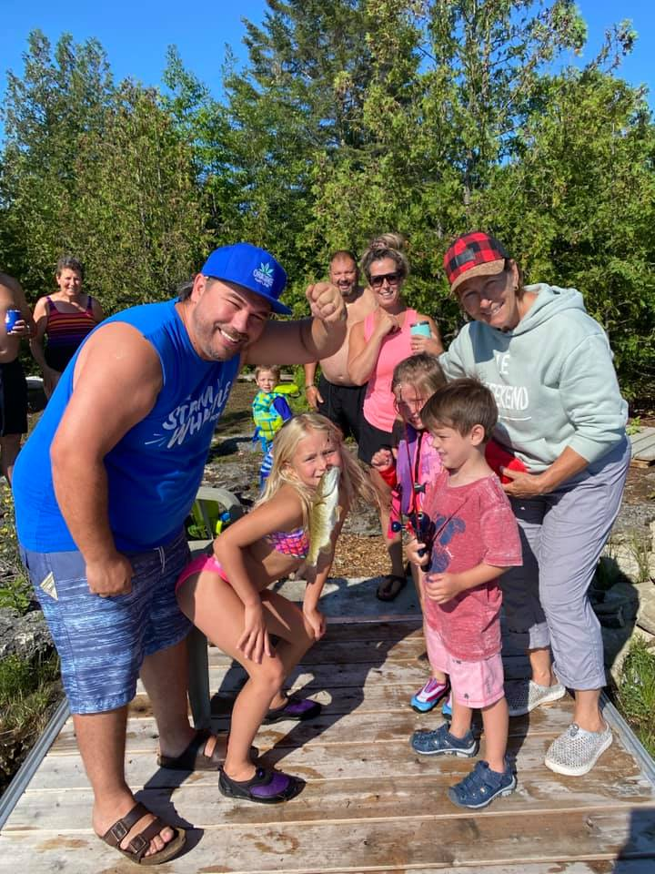 Family fishing while glamping on Farr Island