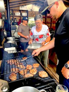 Cooking hamburgers on Farr Island glamping
